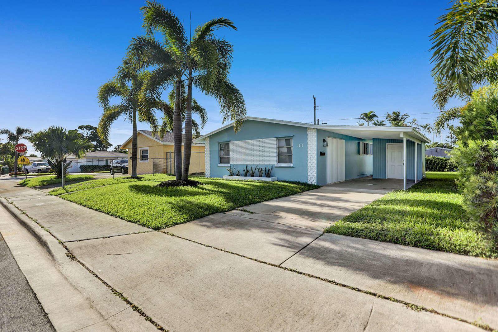 Photo of 1111 W 4th Street, Riviera Beach, FL 33404 (MLS # RX-10654209)