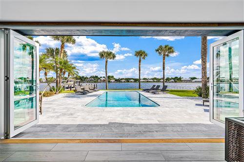 Photo of 11670 Lake Shore Place, North Palm Beach, FL 33408 (MLS # RX-10678211)