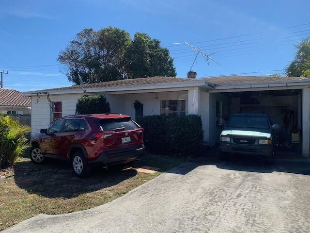 Photo of 111 E 28th Street, Riviera Beach, FL 33404 (MLS # RX-10690211)