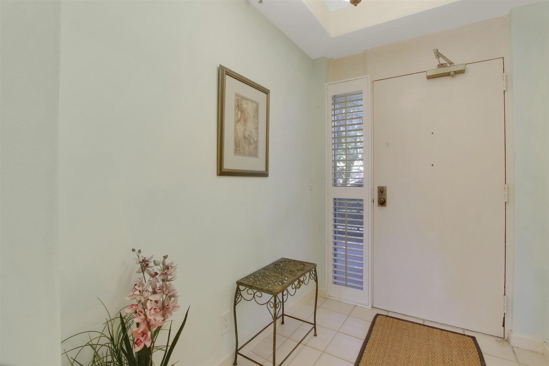 Photo of 11370 Twelve Oaks Way #212, North Palm Beach, FL 33408 (MLS # RX-10732211)