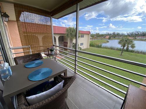 Photo of 123 Lake Frances Drive, West Palm Beach, FL 33411 (MLS # RX-10606212)
