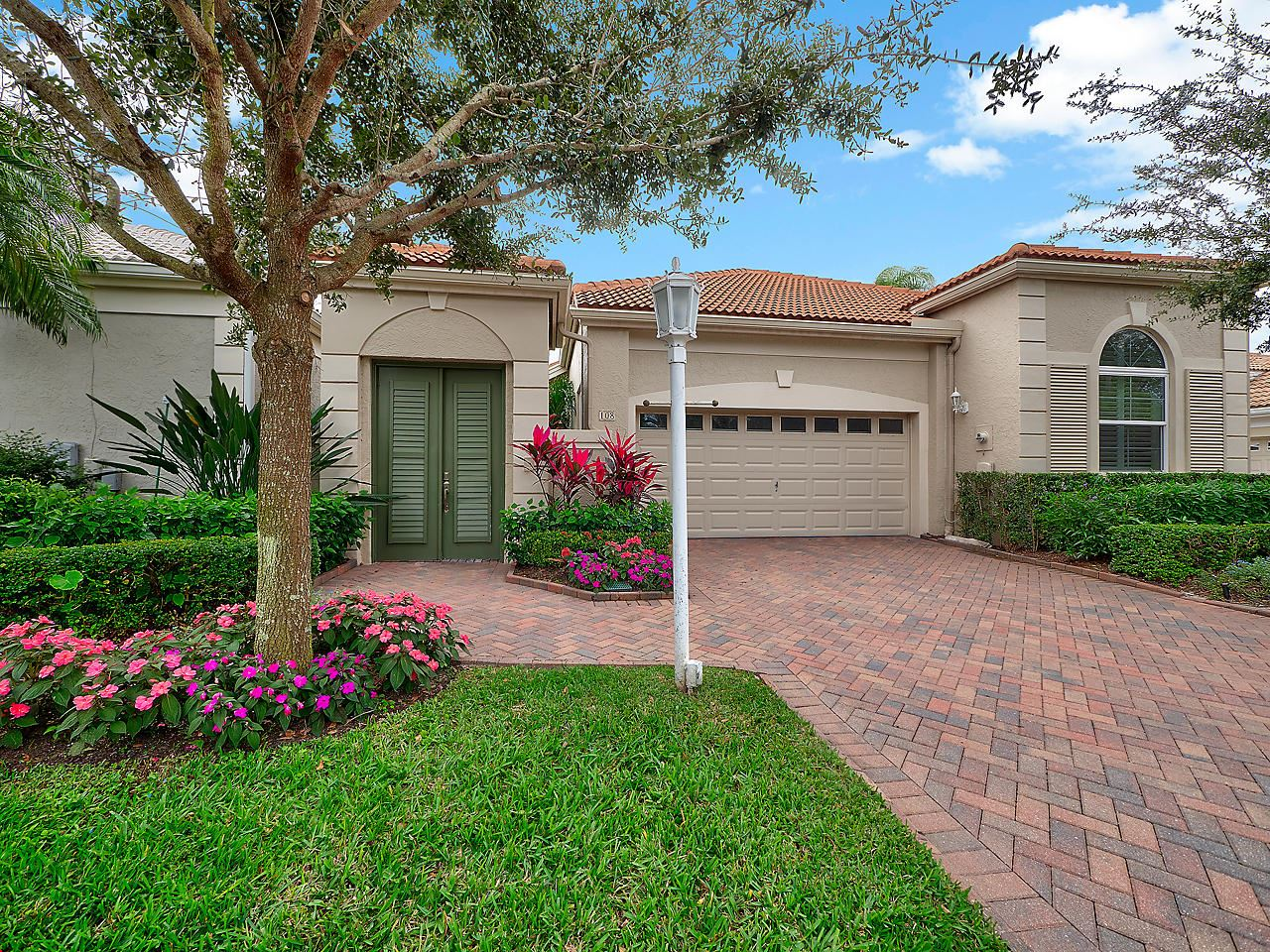 Photo of 108 Coral Cay Drive, Palm Beach Gardens, FL 33418 (MLS # RX-10591212)