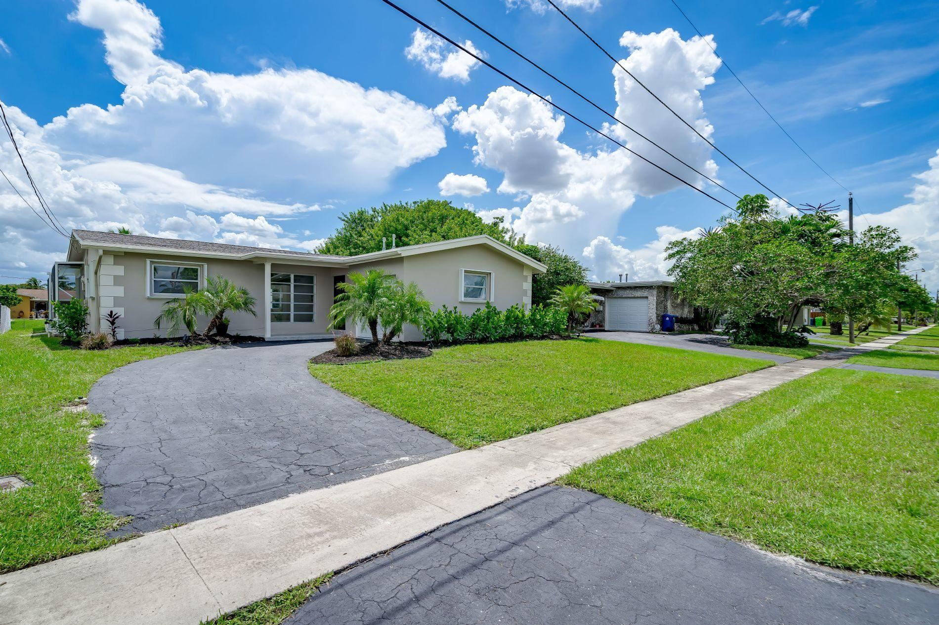 Photo of 8570 NW 24th Place, Sunrise, FL 33322 (MLS # RX-10654213)
