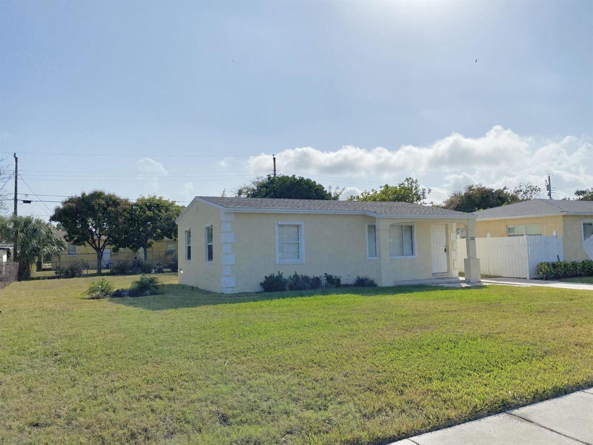 Photo of 331 W 28th Street, Riviera Beach, FL 33404 (MLS # RX-10691215)