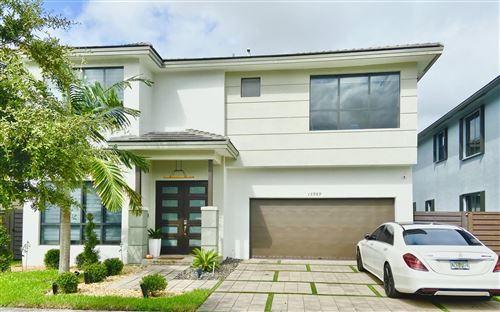 Photo of 15989 SW 136th Way, Miami, FL 33196 (MLS # RX-10696219)
