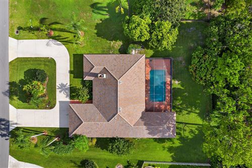 Photo of 6464 Wood Lake Road, Jupiter, FL 33458 (MLS # RX-10731219)