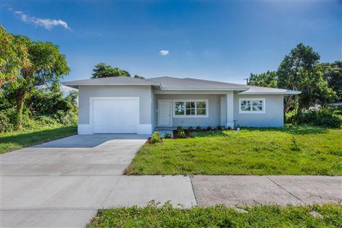 Photo of 304 E Lake Road, Palm Springs, FL 33461 (MLS # RX-10754219)