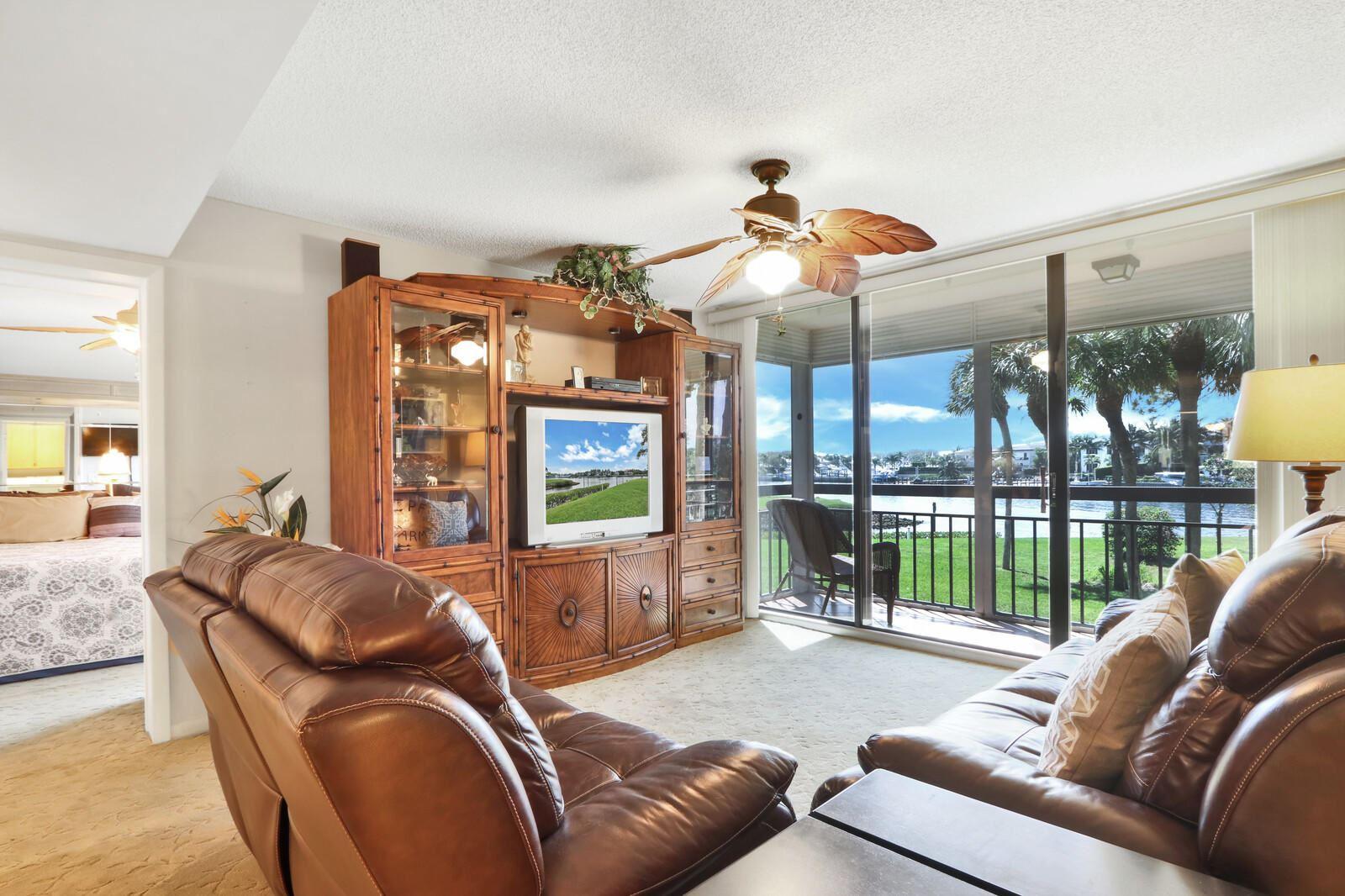 Photo of 2201 Marina Isle Way #205, Jupiter, FL 33477 (MLS # RX-10695221)