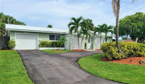 Photo of 3821 Buttercup Circle N, Palm Beach Gardens, FL 33410 (MLS # RX-10754222)