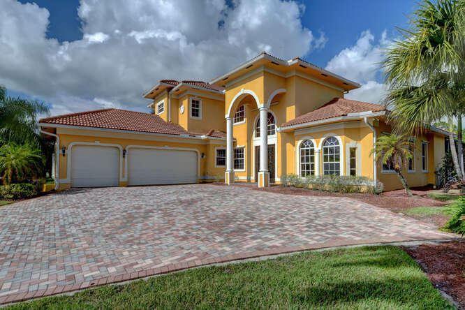Photo of 1063 SW Squire Johns Lane, Palm City, FL 34990 (MLS # RX-10620224)