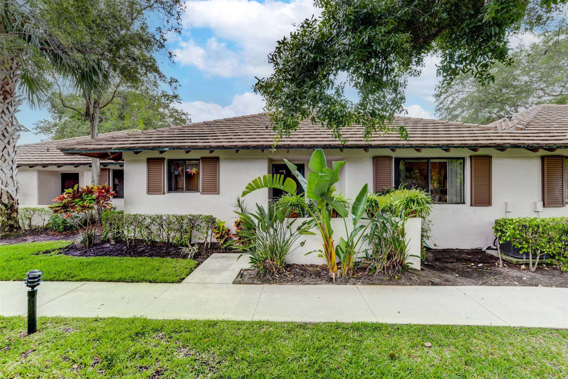 Photo of 214 Club Drive, Palm Beach Gardens, FL 33418 (MLS # RX-10716225)
