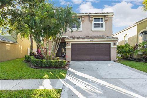 Photo of 1248 Oakwater Drive, Royal Palm Beach, FL 33411 (MLS # RX-10636231)