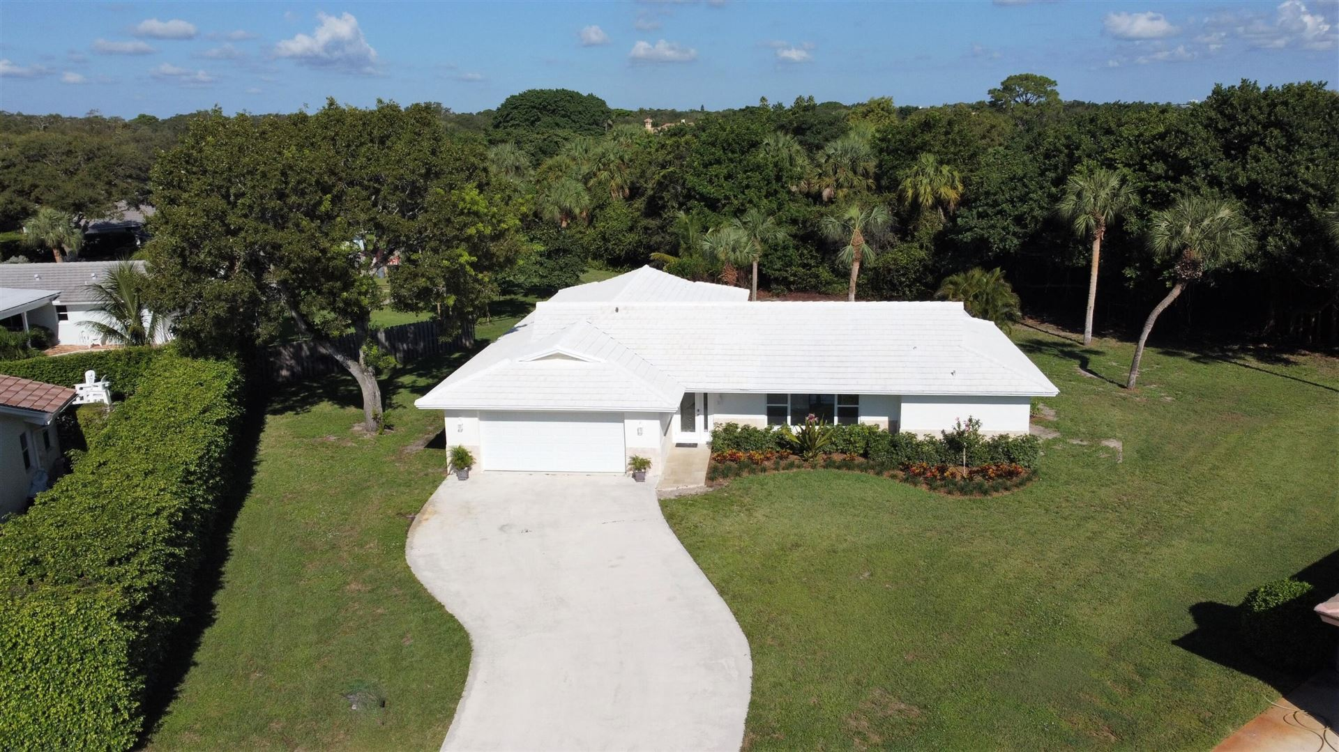 Photo of 2073 Ascott Circle, North Palm Beach, FL 33408 (MLS # RX-10752231)