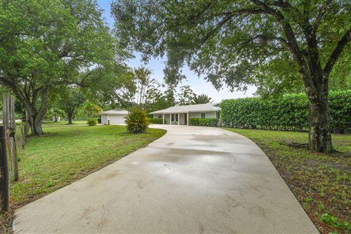 Photo of 16582 Mellen Lane, Jupiter, FL 33478 (MLS # RX-10736232)
