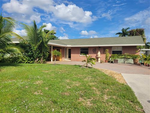 Photo of 10044 Dasheen Avenue, Palm Beach Gardens, FL 33410 (MLS # RX-10753232)