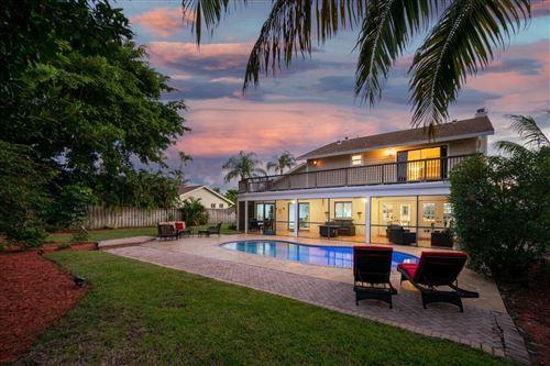 Photo of 4135 Birchwood Drive, Boca Raton, FL 33487 (MLS # RX-10752233)