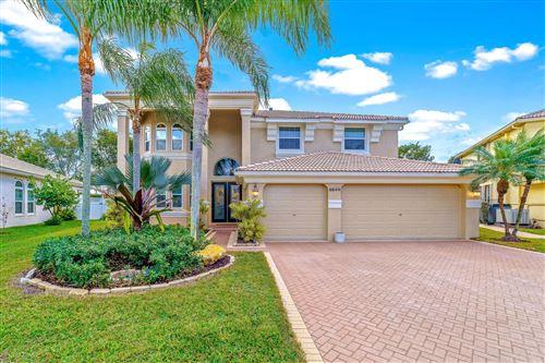 Photo of 6644 Marbletree Lane, Lake Worth, FL 33467 (MLS # RX-10685234)