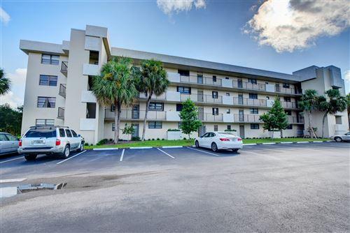 Photo of 2410 Deer Creek Country Club Boulevard #108-E, Deerfield Beach, FL 33442 (MLS # RX-10662238)