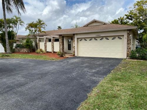 Photo of 10861 NW 21st Street, Coral Springs, FL 33071 (MLS # RX-10606240)