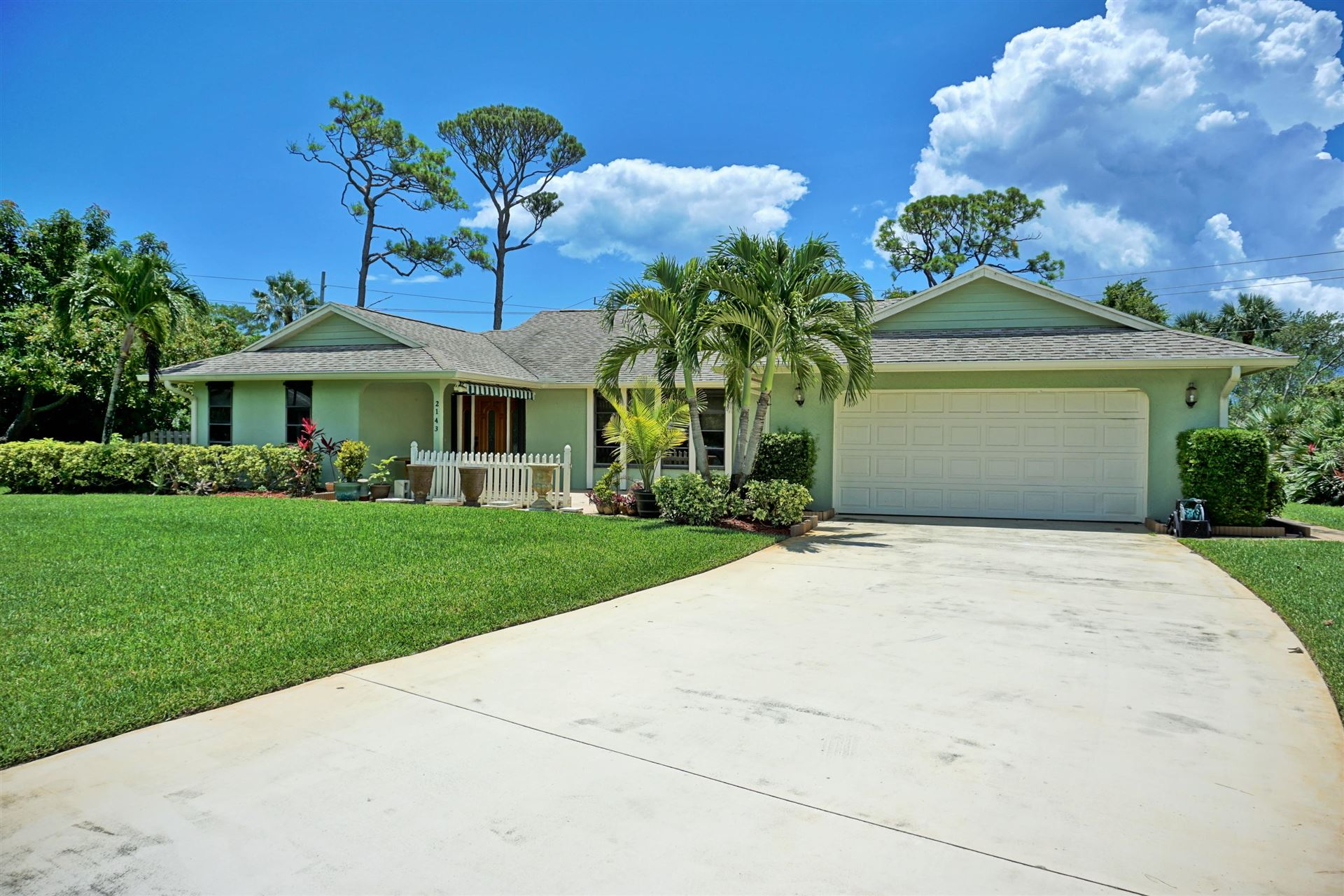 Photo of 2143 NE Marlberry Lane, Jensen Beach, FL 34957 (MLS # RX-10644242)