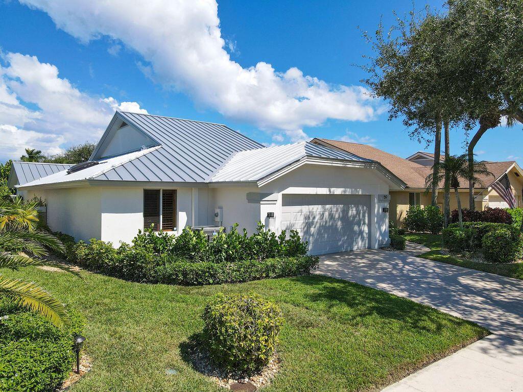 Photo of 159 Sand Pine Drive, Jupiter, FL 33477 (MLS # RX-10749243)