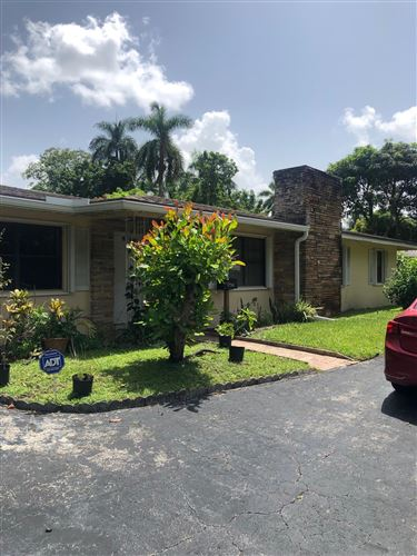 Photo of 824 Holly Lane, Plantation, FL 33317 (MLS # RX-10745244)