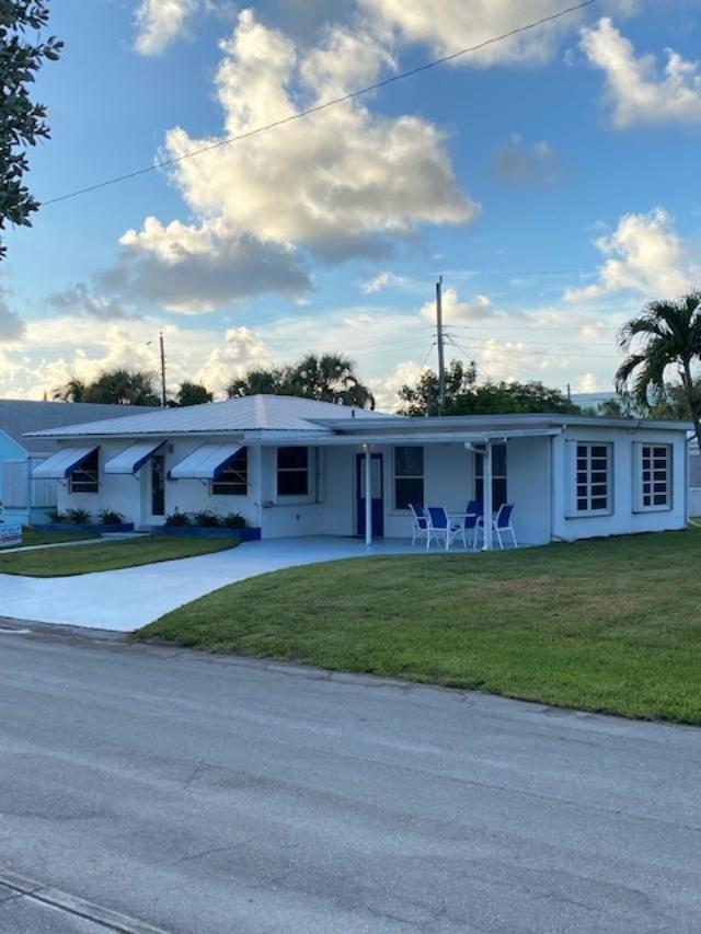 Photo of 208 E 22nd Court, Riviera Beach, FL 33404 (MLS # RX-10648244)