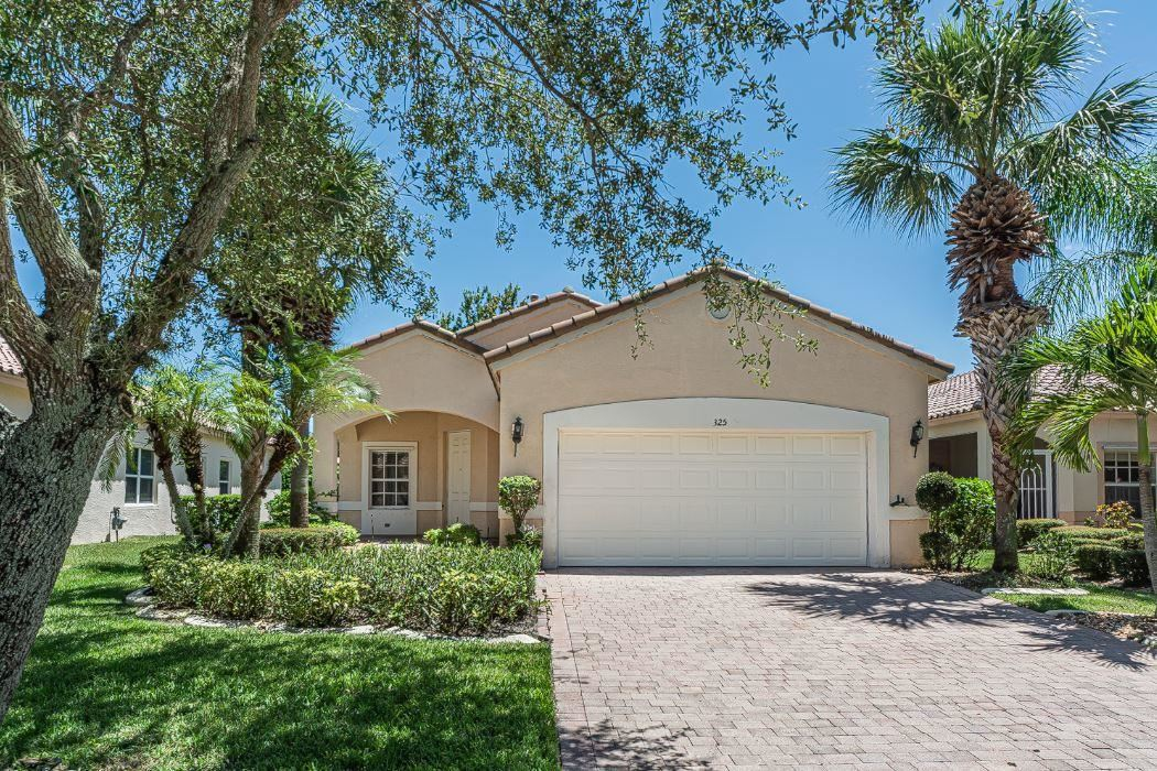 Photo of 325 NW Breezy Point Loop, Port Saint Lucie, FL 34986 (MLS # RX-10643255)