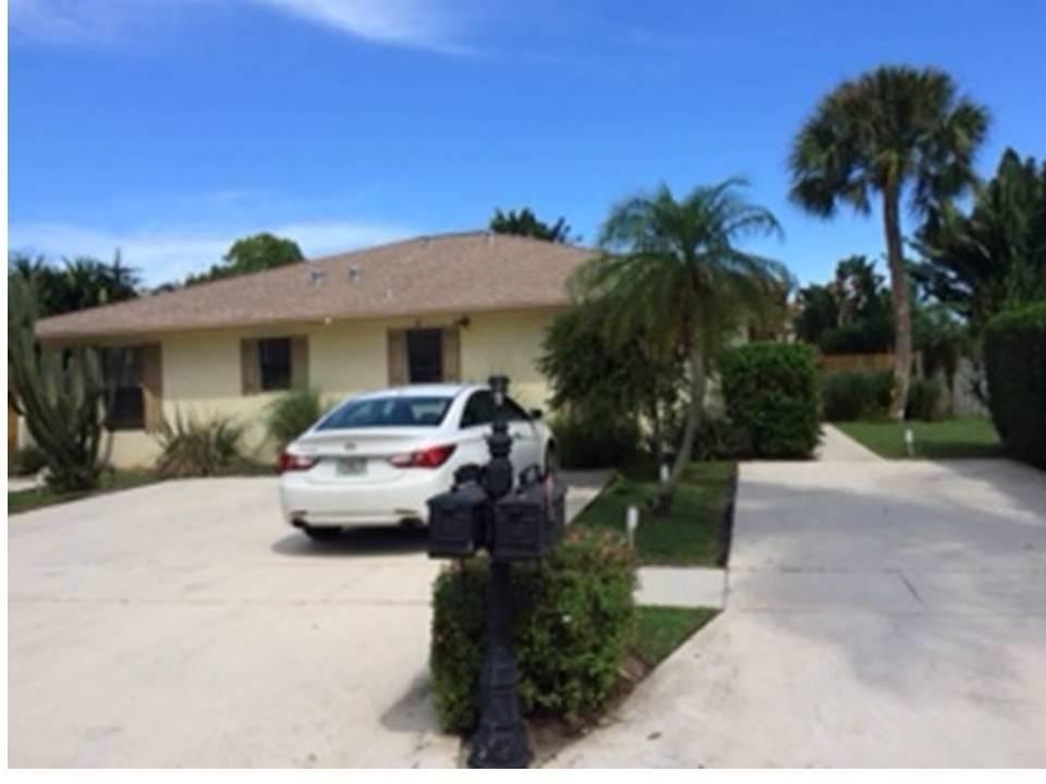 Photo of 9130 E Highland Pines Boulevard, Palm Beach Gardens, FL 33418 (MLS # RX-10685258)