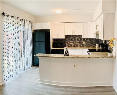 Photo of 1480 Masters Circle #170, Delray Beach, FL 33445 (MLS # RX-10636259)