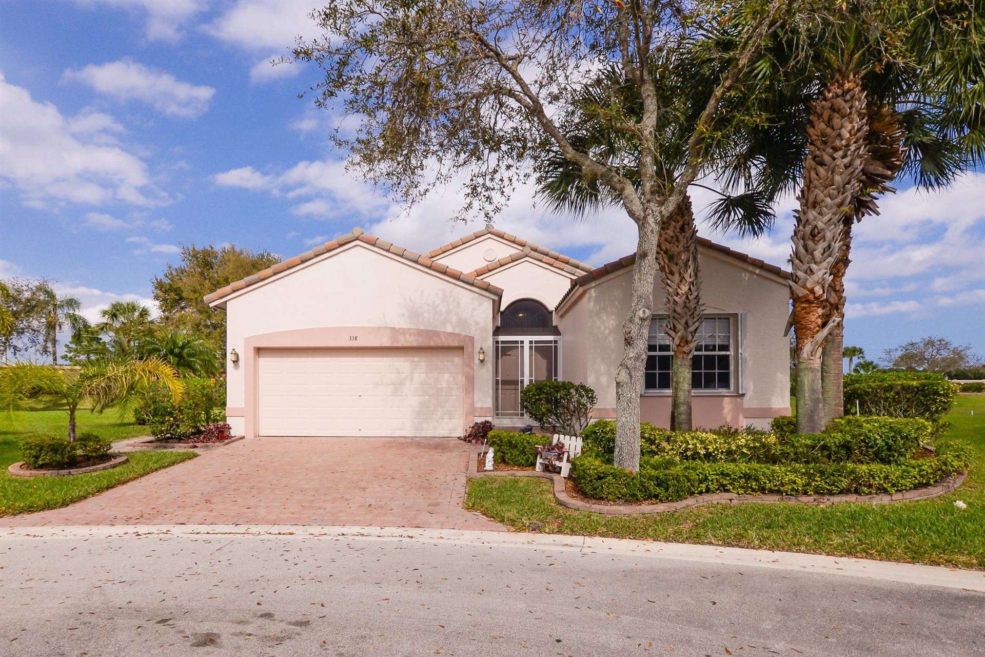 Photo of 338 NW Millpond Lane, Port Saint Lucie, FL 34986 (MLS # RX-10695259)