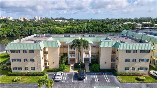Photo of 7 Colonial Club Drive #101, Boynton Beach, FL 33435 (MLS # RX-10667263)