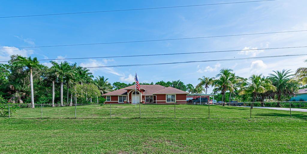 Photo of 18057 Orange Grove Boulevard, Loxahatchee, FL 33470 (MLS # RX-10736263)