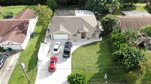 Photo of 318 SE Evans Avenue, Port Saint Lucie, FL 34984 (MLS # RX-10667266)