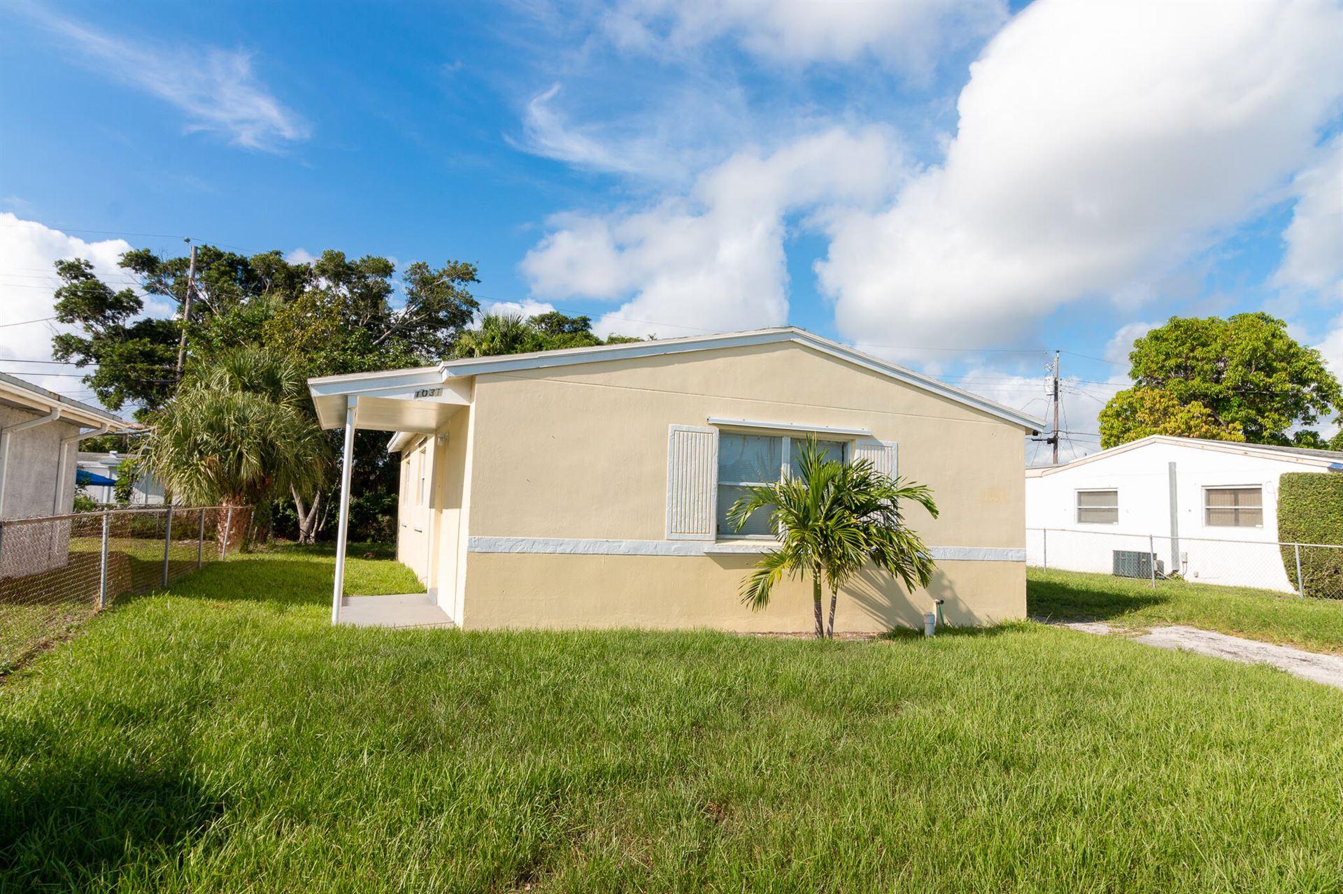 Photo of 1031 W 3rd Street, Riviera Beach, FL 33404 (MLS # RX-10729272)