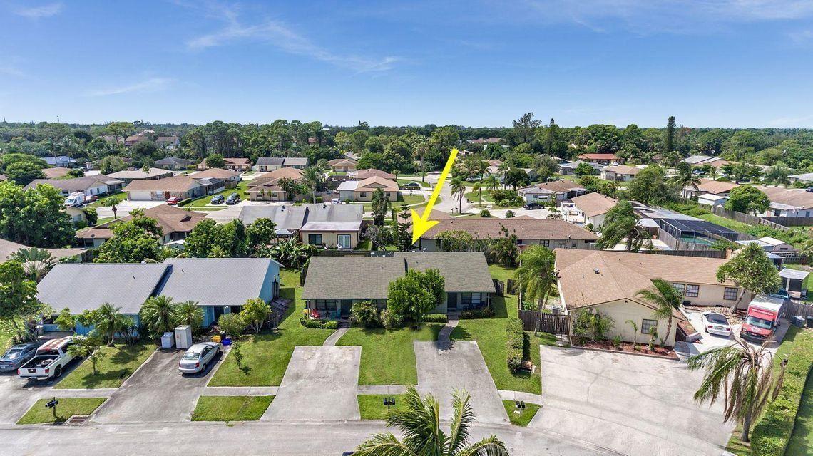 Photo of 9221 W Highland Pines Drive #9221/9223, Palm Beach Gardens, FL 33418 (MLS # RX-10752272)