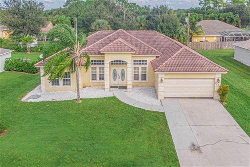 Photo of 1437 SW Sudder Avenue, Port Saint Lucie, FL 34953 (MLS # RX-10667273)