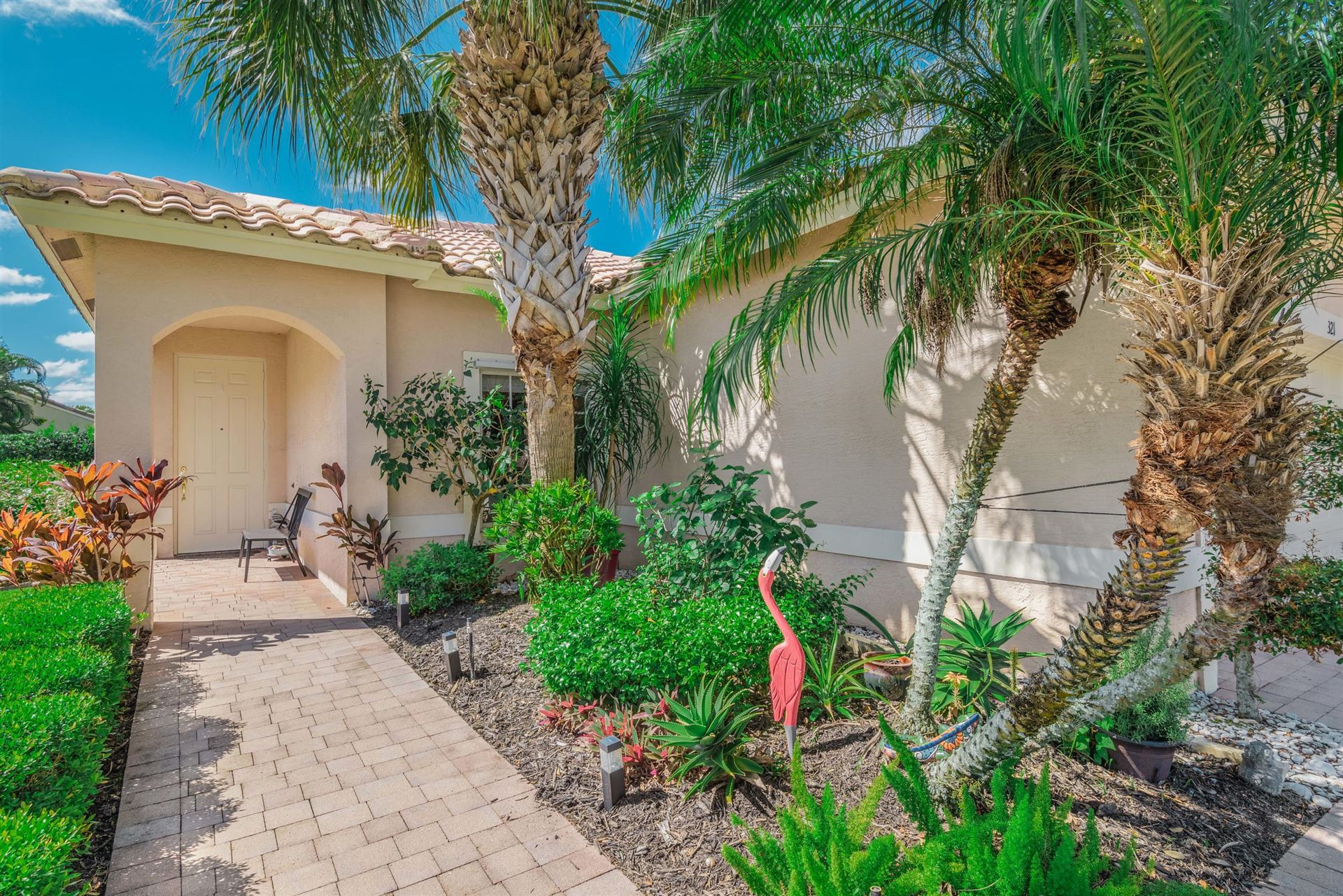 Photo of 321 NW Breezy Point Loop, Port Saint Lucie, FL 34986 (MLS # RX-10635279)