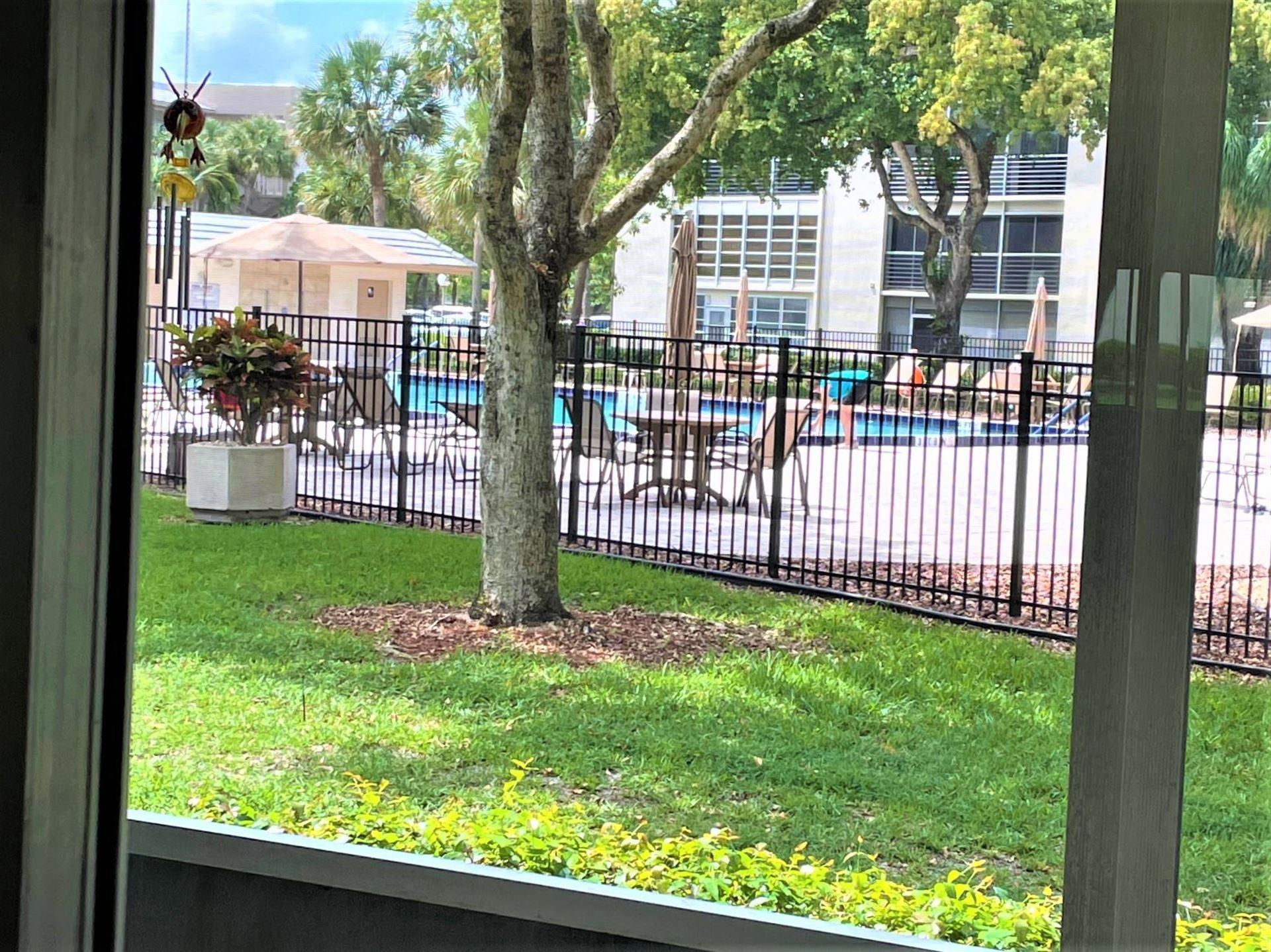 Photo of 2003 Granada Drive #E1, Coconut Creek, FL 33066 (MLS # RX-10715280)