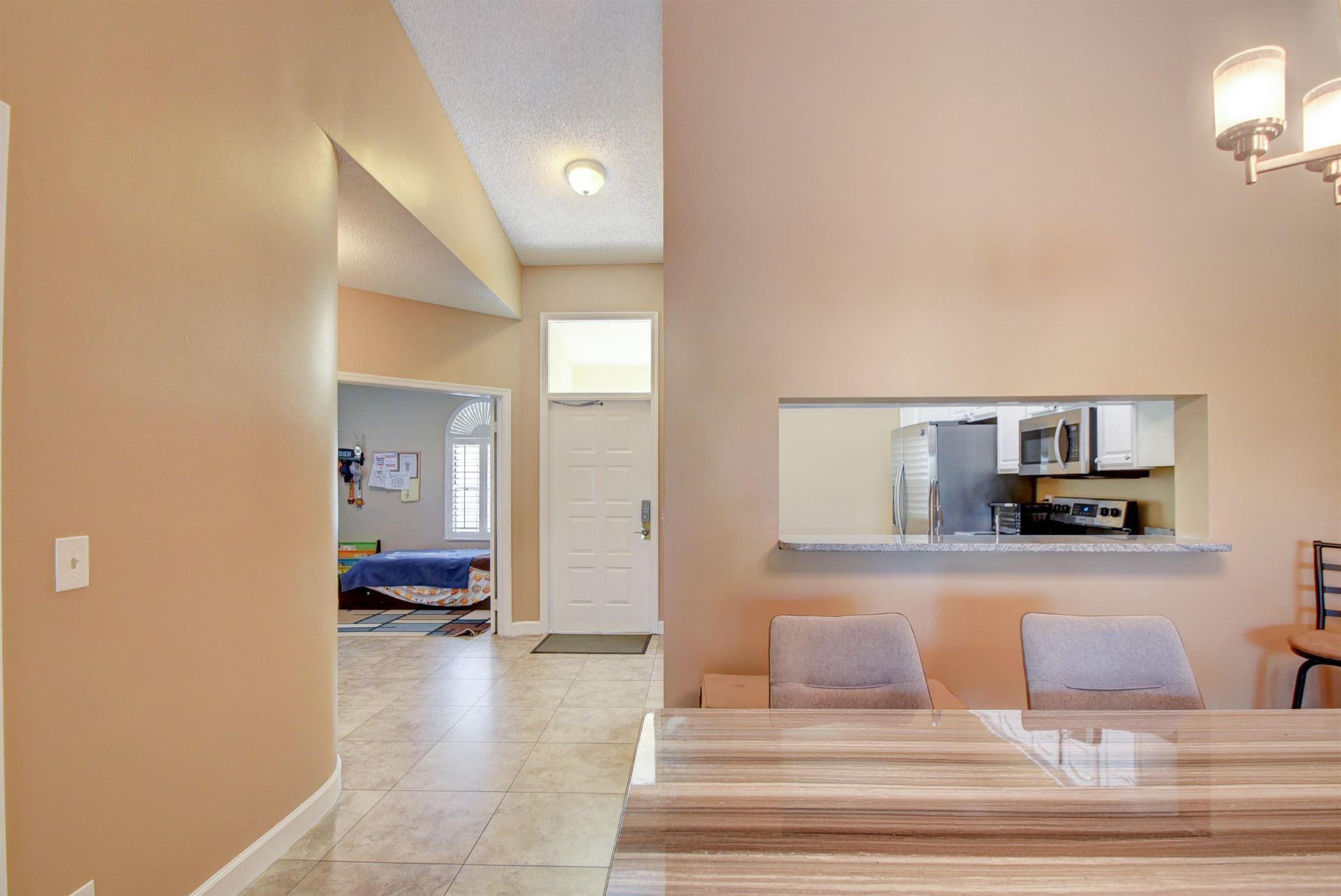 Photo of 200 Cypress Point Drive #200, Palm Beach Gardens, FL 33418 (MLS # RX-10690287)