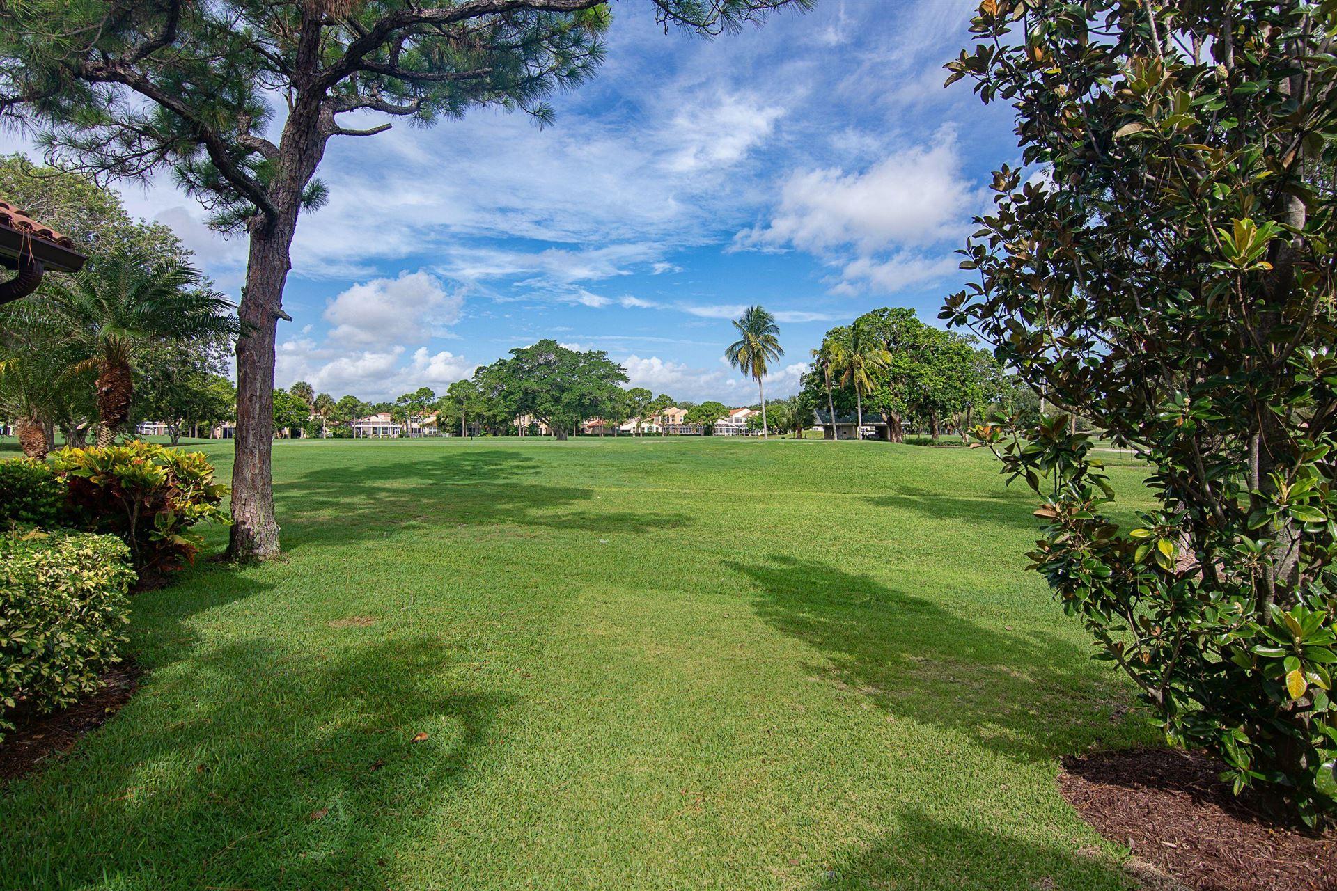 Photo of 19 Ironwood Way N, Palm Beach Gardens, FL 33418 (MLS # RX-10740290)