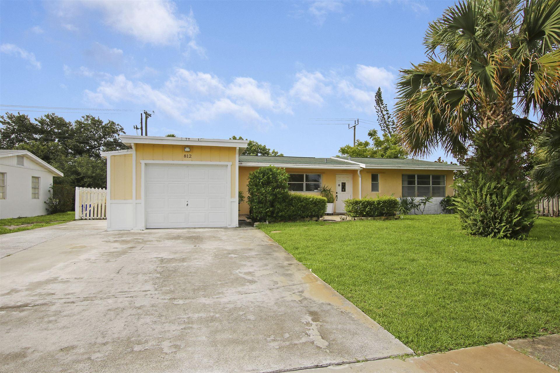 Photo of 812 Dogwood Road, North Palm Beach, FL 33408 (MLS # RX-10724294)