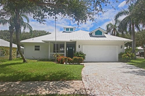 Photo of 136 Intracoastal Circle, Tequesta, FL 33469 (MLS # RX-10670296)
