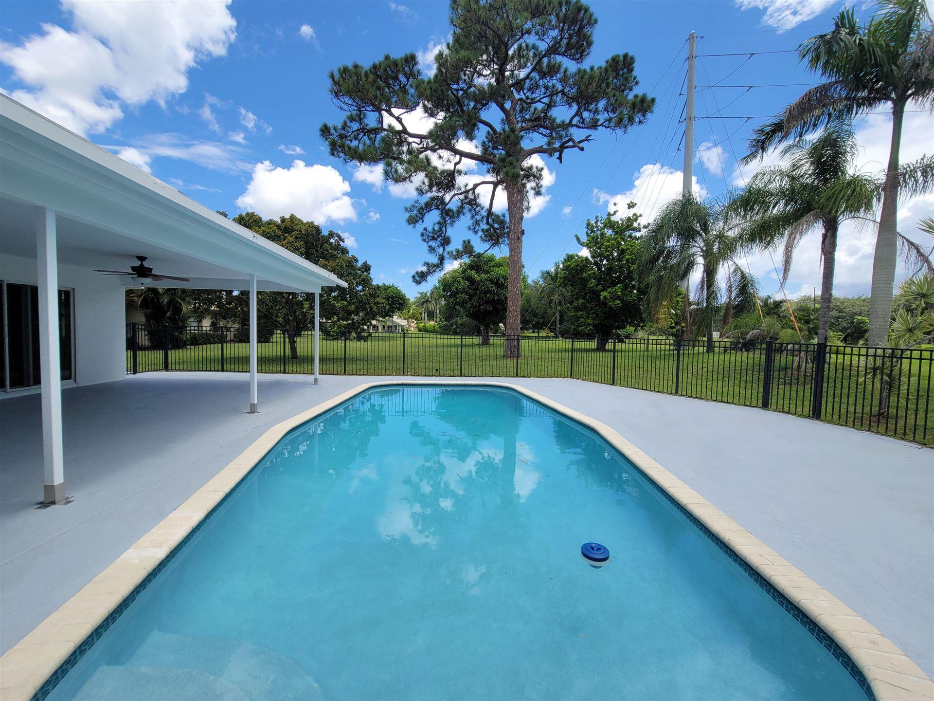 Photo of 2334 NW Timbercreek Circle, Boca Raton, FL 33431 (MLS # RX-10746297)