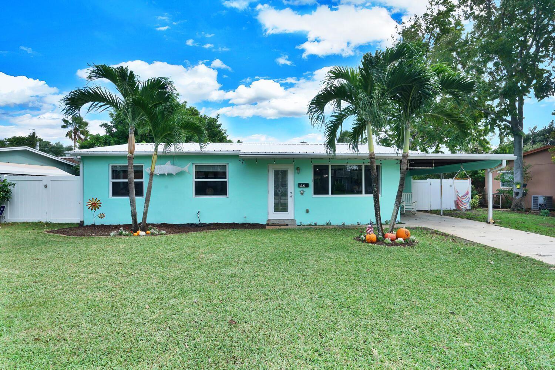 Photo of 745 Cinnamon Road, North Palm Beach, FL 33408 (MLS # RX-10672301)