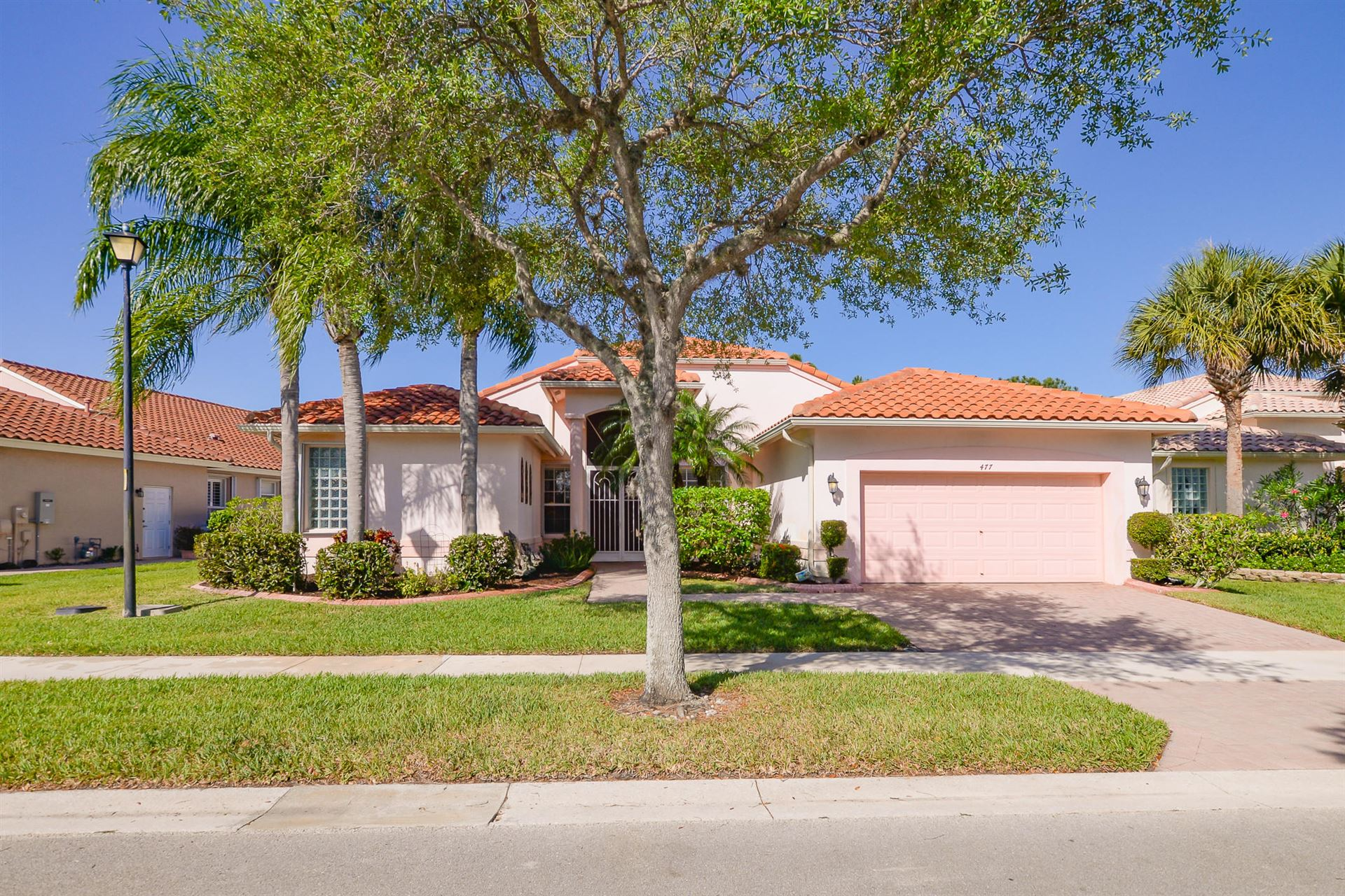 Photo of 477 NW Blue Lake Drive, Port Saint Lucie, FL 34986 (MLS # RX-10705305)