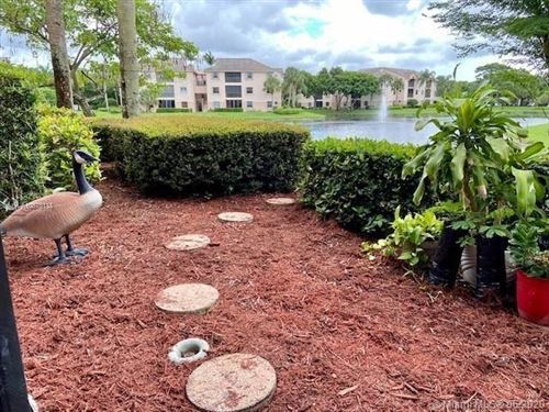 Photo of 4121 Coral Tree Circle #136, Coconut Creek, FL 33073 (MLS # RX-10670306)