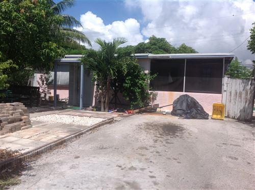 Foto de inmueble con direccion 391 Hibiscus Tree Drive Lantana FL 33462 con MLS RX-10650310