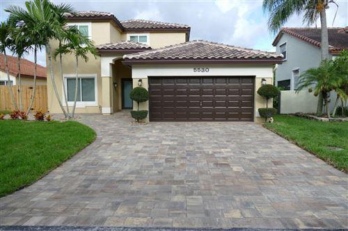 Photo of 5530 NW 51st Avenue, Coconut Creek, FL 33073 (MLS # RX-10635311)