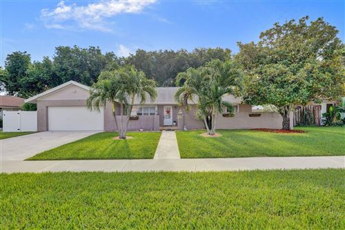 Photo of 4035 Birchwood Drive, Boca Raton, FL 33487 (MLS # RX-10632319)